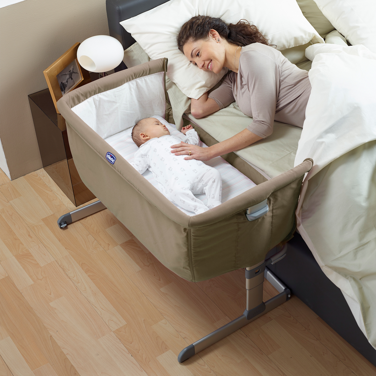 combos next to table bed critic in attached changing cribs top with crib baby