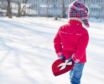 Valentine child carrying gift